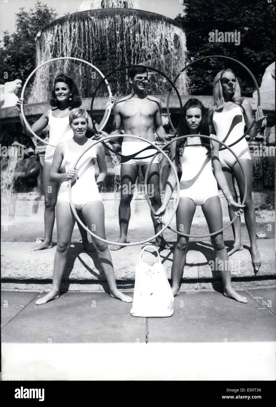 Sep. 05, 1967 - These models are showing off bathing suits for the1968 bathing season. The suits were made in Munich's ''Kuenstlerhaus.'' This picture shows the bathing suit mockup entitled ''Olympia,'' which was made for the Mexico Olympic games. - Stock Image