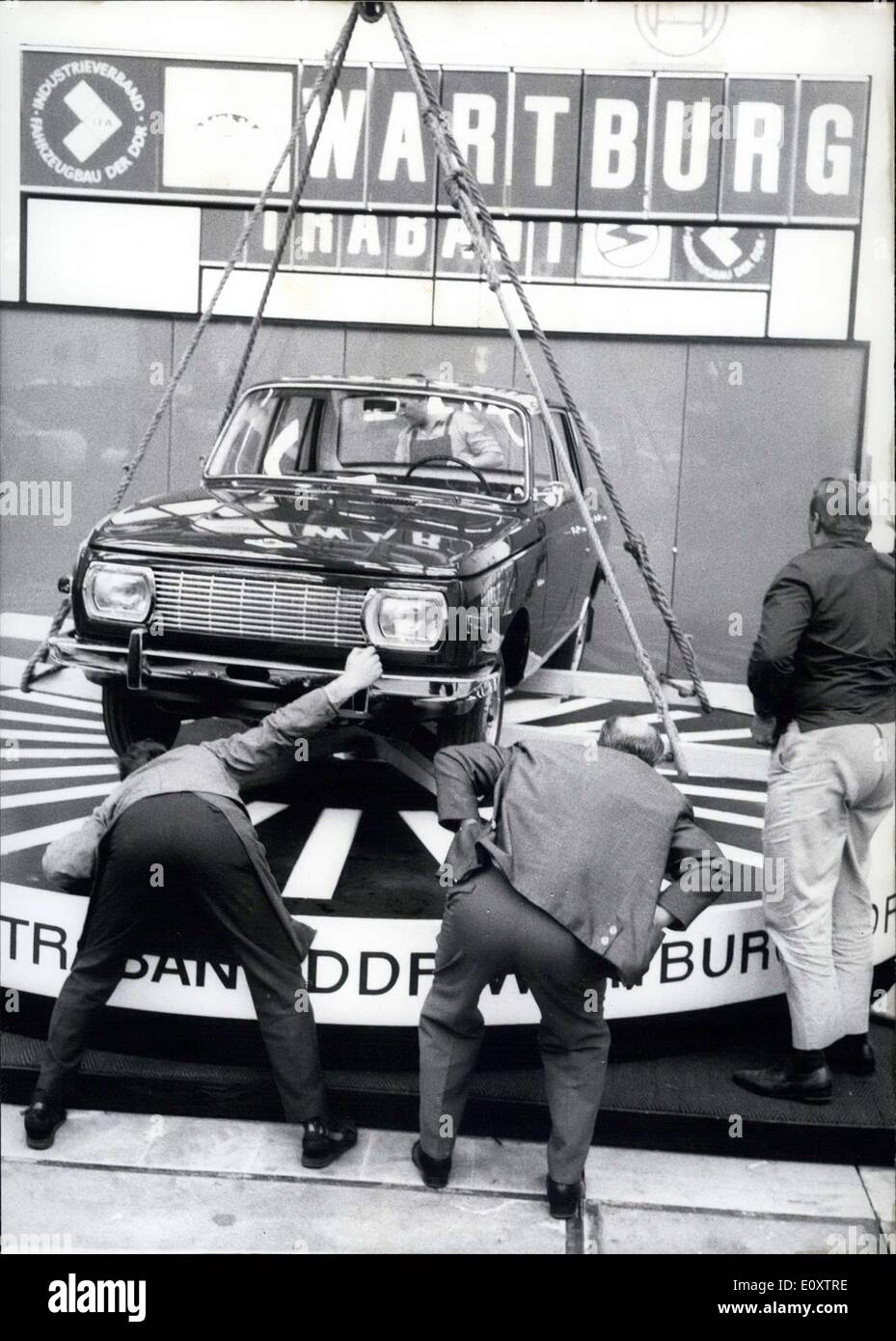 Sep. 14, 1967 - These visitors are at the 42nd International Automobile Fair in Frankfurt/Main. The car they are looking at is a new ''Wartburg'' from the DDR, not something you see every day. Interest in automobiles from Eastern Europe was big at the fair. - Stock Image