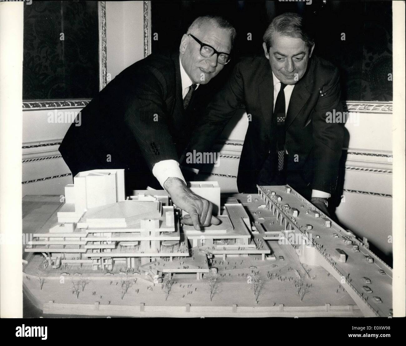 Nov. 22, 1967 - 22-11-67 Press conference on the National Theater on the South Bank Plan. A press conference was held today at the Arts Council, St. James' Square on the National Theater on the South Bank plan. Keystone Photo Shows: Sir Laurence Olivier on left, and Mr. Denys Lasdun, the architect, on right, seen looking at the model of the new National Theater which will be built on the South Bank. - Stock Image