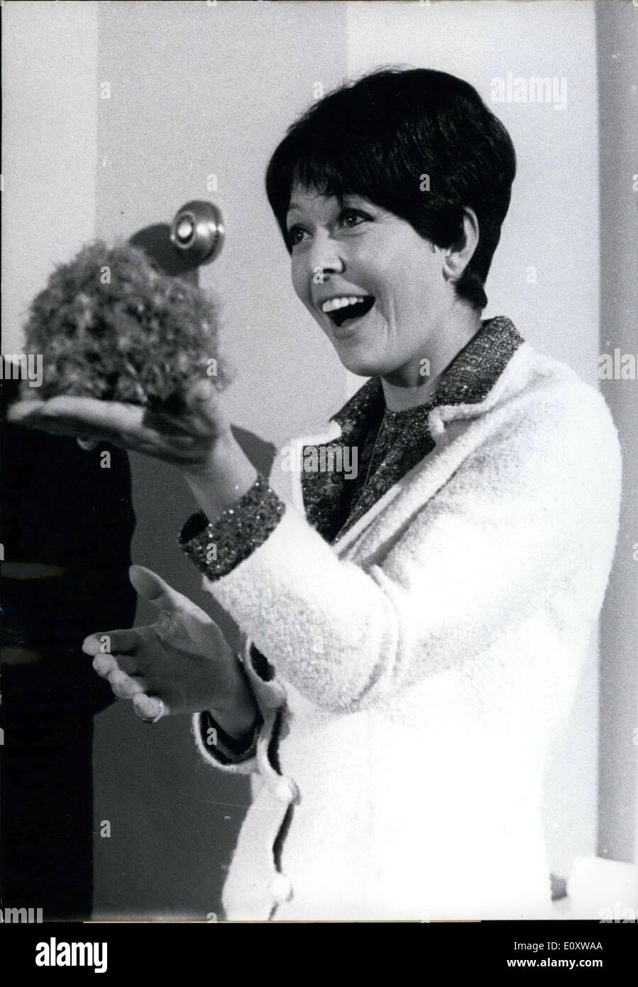 Nov. 29, 1967 - A wonder in the hand. Ursula von Manescul, beloved television announcer of Southwest Radio Baden-Baden, opened her closed fist and, within three seconds, this fluffy ball of eider down puffed up. The countless journalists in the Hamburg press center marveled at it. The wanted to know about the physical qualities of the feathers and long-lasting down in the feather beds. - Stock Image