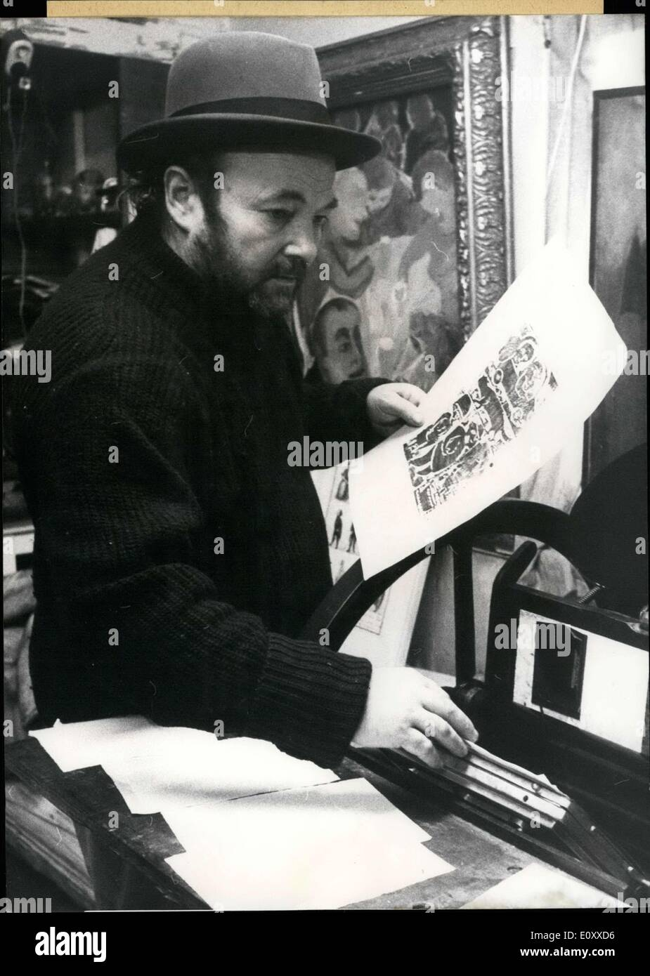 Mar. 05, 1968 - The Berlin original Kurt M?hlenhaupt is an author, composer, printer, and publisher all in one. ''Kurtchen,'' as his friends call him, once led the Kreuzberg photo market to flourish. Now, he is undertaking writing. His first product is named ''Bartgeschichten'' and depicts an incident at Berlin's eastern sector-boundary. The book - whose circulation is ever climbing - is richly illustrated with woodcuts and an authentic ''collector's joy.'' You can buy it directly in Kurtchen's shop and it will surely be signed. Pictured: Kurt M?hlenhaupt at his press machine. - Stock Image