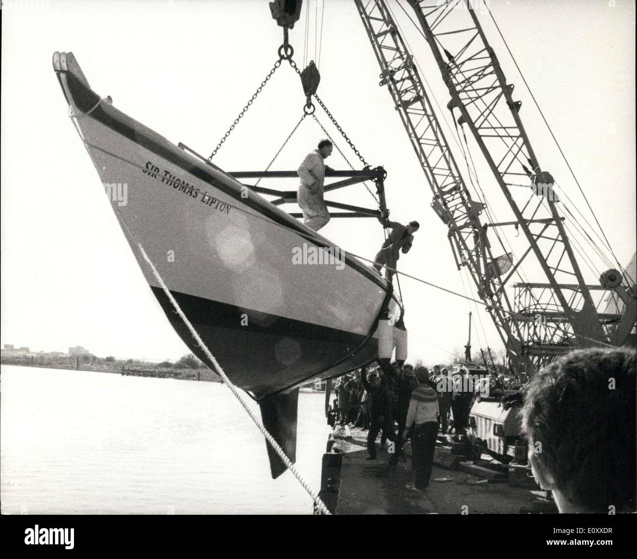 Mar. 10, 1968 - Transatlantic Race Hop Is Launched. The 57-foot sir Thomas Lipton, the largest British yacht entered for the 1968 Singlehanded Trans-Atalntic race, was launched this weekend at Snadwich Kent. Built by her owner and helmsman, 25-year old Oxford graduate, Geoffrey Williams, and Derek Kelsall, the 12-ton yacht had the forward wheels of the mobile cranes used for the launch lifting off the ground as they eased her into the muddy waters of the River tour at Richborough quay - Stock Image