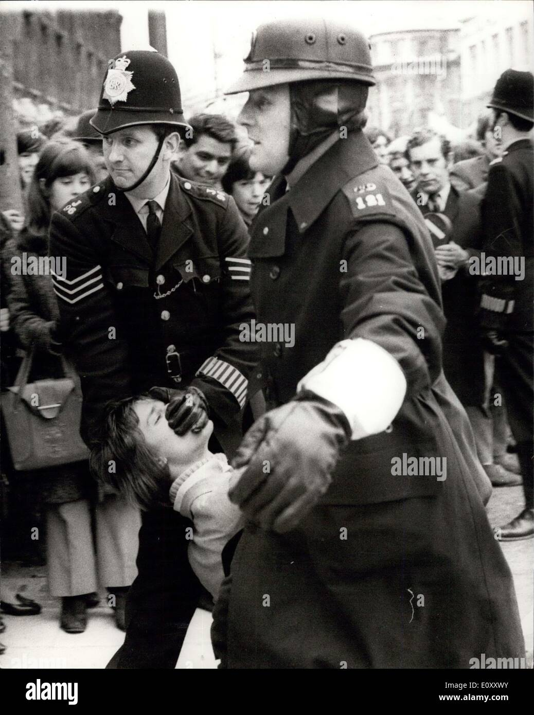Mar. 24, 1968 - Youth Campaign For Nuclear Disarmament stage Anti-Vietnam War Demonstration: The Youth Campaign for Nuclear Disarmament today staged an anti-Vietnam war demonstration in Trafalgar Square, followed by a march to Downing Street where petitions were handed in to No.10. Photo shows: A police officer clamps his hand over the mouth of one of the demonstrators as he is dragged away in Whitehall today. - Stock Image