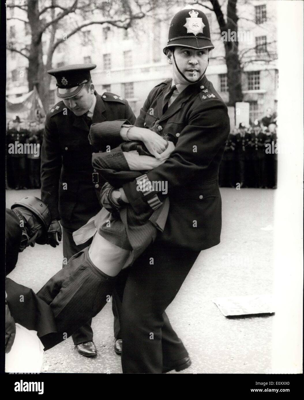 Mar. 24, 1968 - Youth Campaign for Nuclear Disarmament Stage Anti-Vietnam war Demonstration: The Youth Campaign for Nuclear Disarmament today staged an anti-Vietnam war demonstration in Trafalgar Square, followed by a march to Downing Street, where petitions were handed in to No. 10. Photo Shows One of the demonstrators is forcably removed by police at the entrance to Downing Street during the demonstration today. - Stock Image