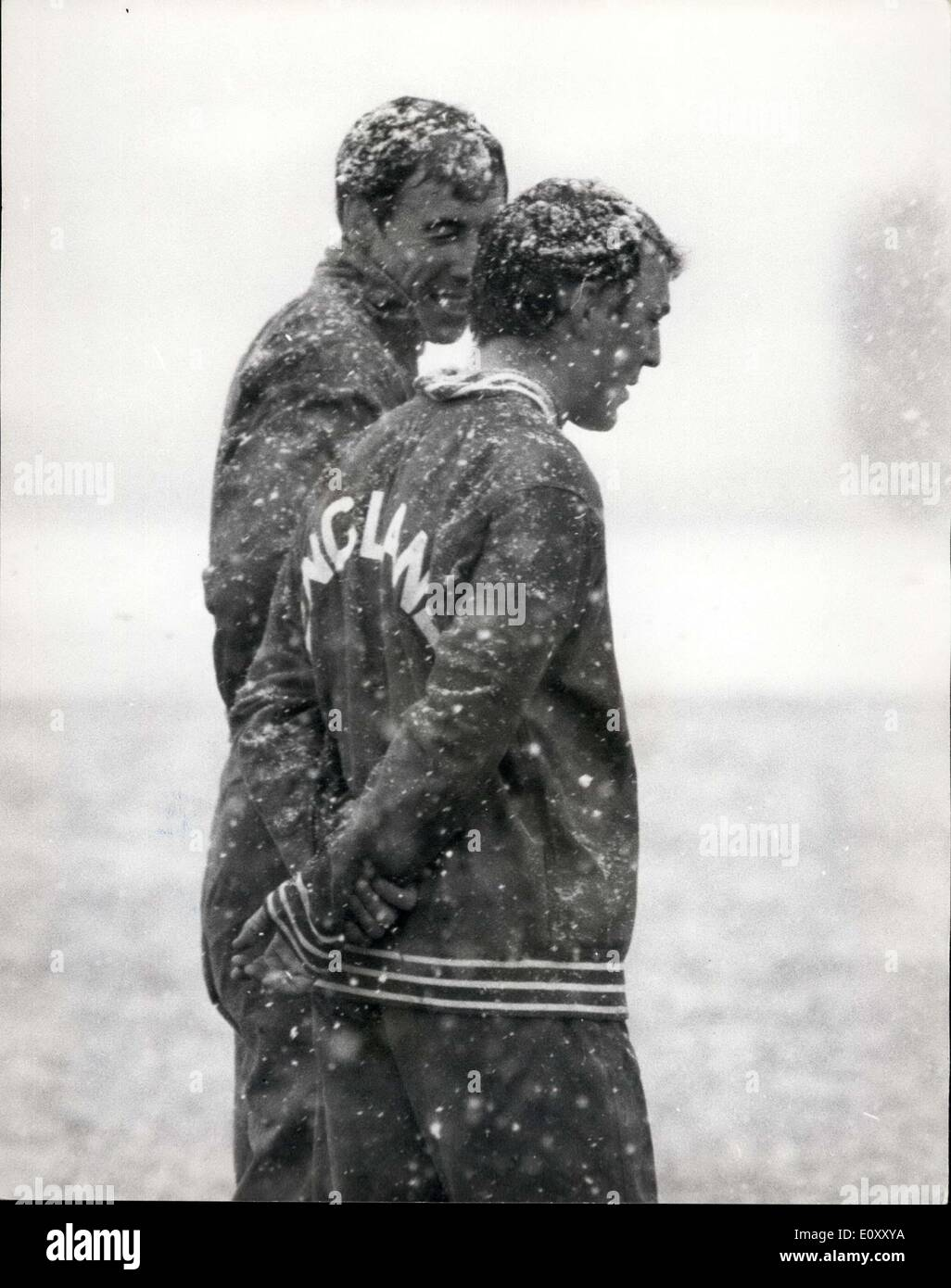 Apr. 02, 1968 - England Footballers train for tomorrow's match against Spain. England footballers were at Rochampton today, training for tomorrow's match against Spain in the European Nations Cup final first leg - at Wembley. Photo shows Gordon Banks (left) chats to Jimmy Greaves as they stand in the snowstorm during a training spell. - Stock Image