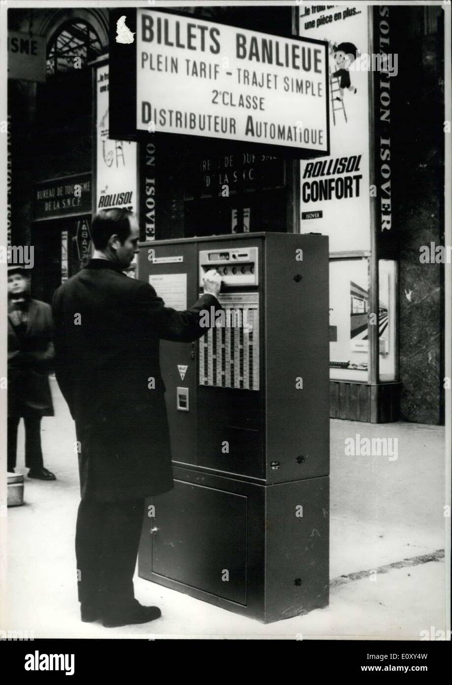 Jan. 26, 1968 - You no longer have to waste time standing in line to buy a ticket thanks to these automatic ticket dispensers. You only have to push the button corresponding to your destination and then you will see the price of your ticket. After giving you your price, the machine prints the ticket, ejects it, and gives you back your change. - Stock Image