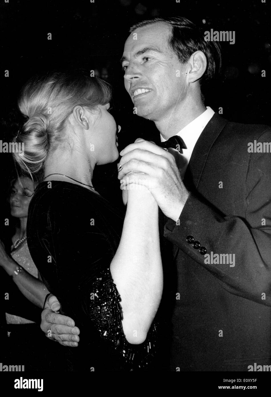 Jan 29, 1968; Munich, Germany; The surgeon CHRISTIAN BARNARD was invited to a ball in Munich Germany where he was dancing with CATHY BILTON. - Stock Image