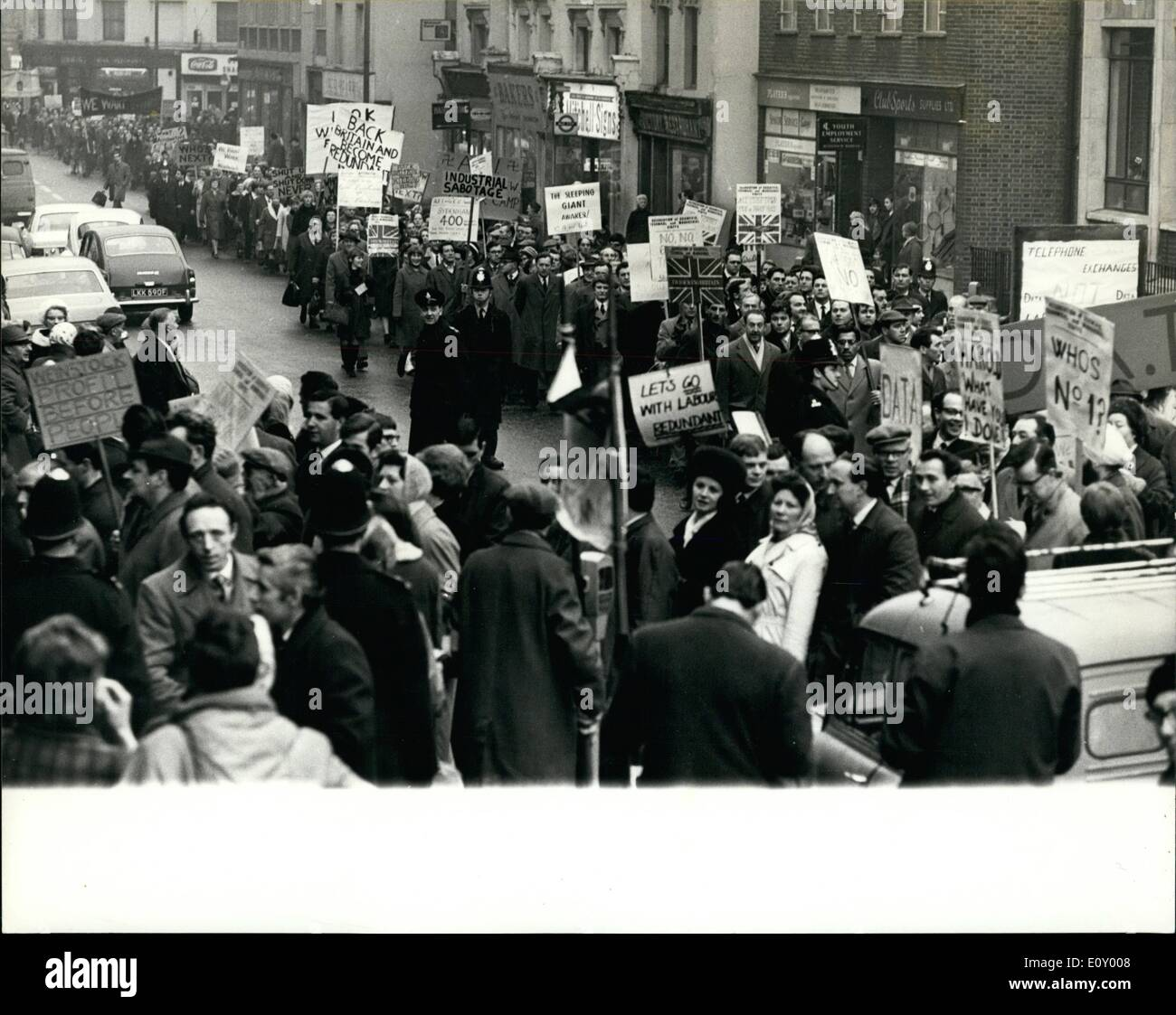 Feb. 02, 1968 - Workers in Protest March.: Five thousand angry men and women downed tools yesterday in protest over plans to shut their factory. The workers, from the Associated Electrical Industries plant in Woolwich, London, then marched in a mile-long queue to a cinema where they met union chiefs. Mr. Christopher Mayhew, M.P. for East Woolwich, who addressed the meeting, described the company's decision to close the factory as a ''bombshell which has wrecked the entire area's employment situation .'' Photo shows the workers seen during their protest match through Woolwich yesterday. - Stock Image