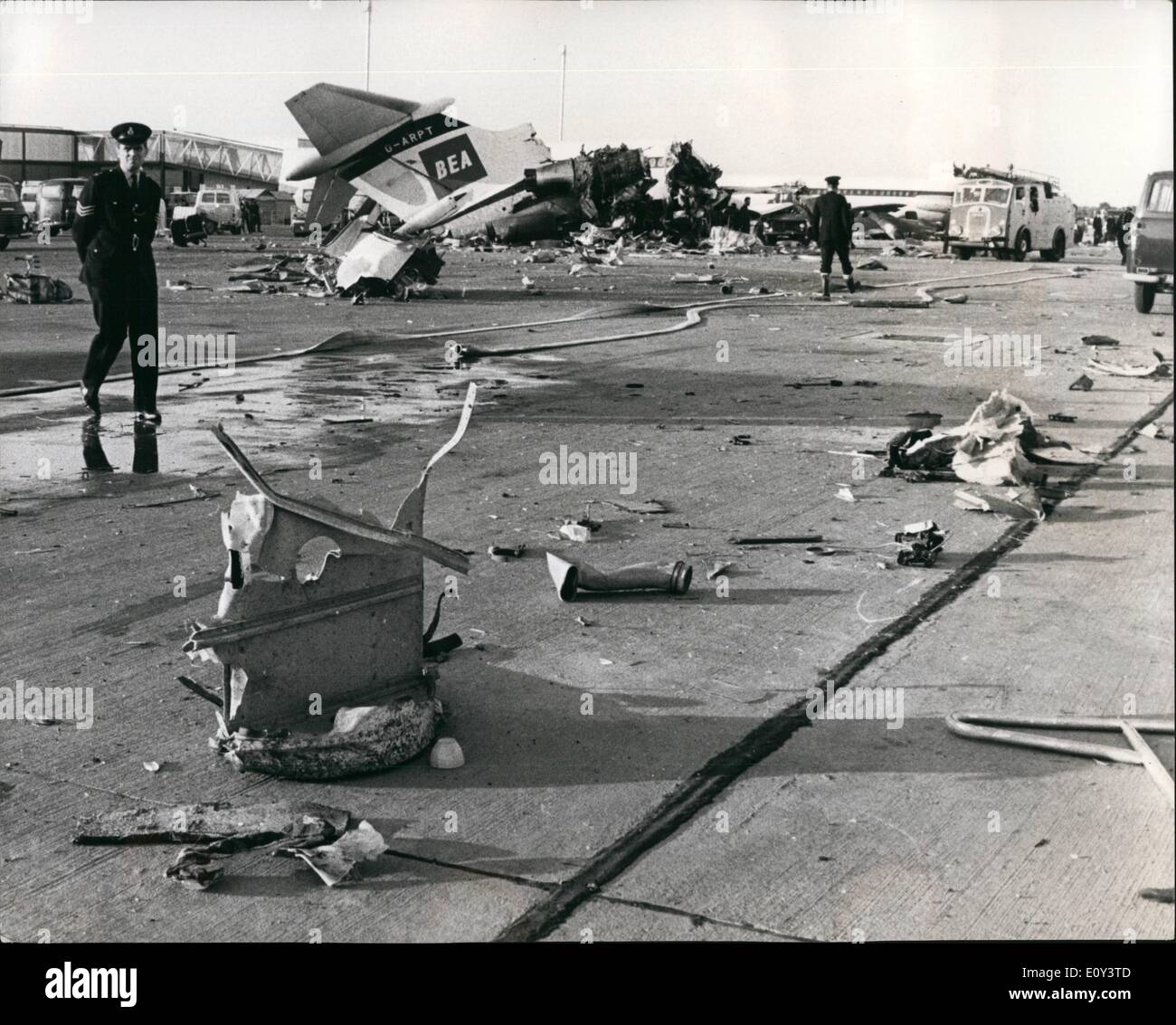 Jul. 07, 1968 - Six People were killed and six injured as an Elizabethan fceighter of BKS - the independent airlines, crashed on landing at Heathrow Airport yesterday, struck three parked BEA airliners and smashed into the wall of a passenger building under construction, the crashed plane was returning eight broad mares and foals from Deauville, France, to stud farms in the Sout of England. The plane's grew of three and three grooms on board died. all the horese were killed or had to be destroyed - Stock Image
