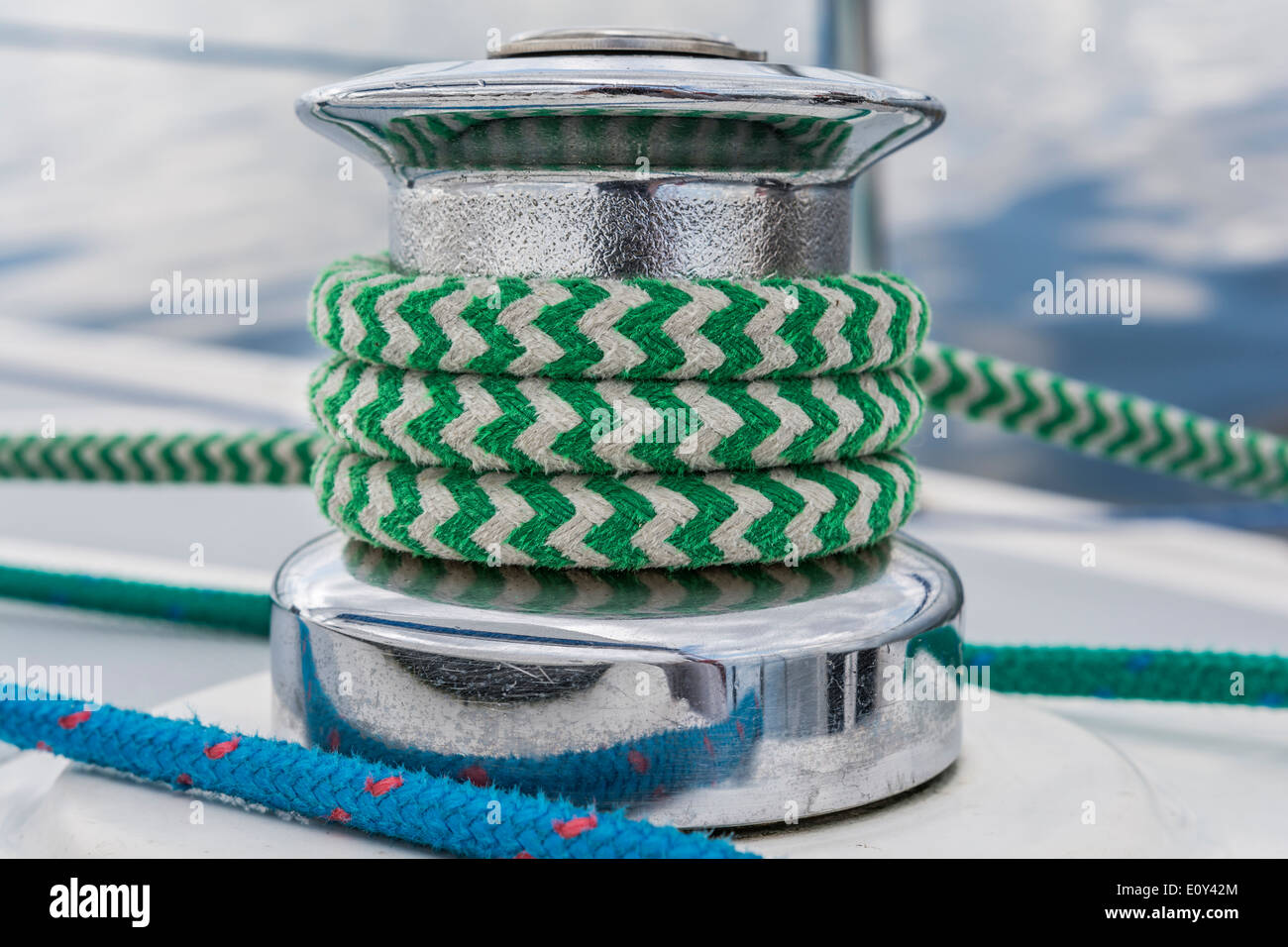 Sail yacht - close up on winch and green rope - Stock Image