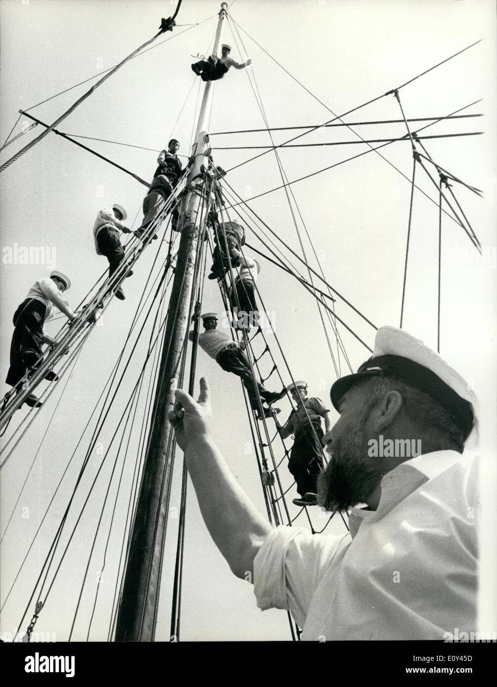 Jul. 07, 1968 - Sea cadet crops entry for the tall ships race. Sea Cadets were at Chatham today training aboard the T.S. Kenya Jacaranda, 94-ton ex-Brixham trawler - a Sea Cadet Crops entry in the forthcoming Tall Ships sailing race, from Harwich to Kristiansand, Norway. Photo Shows The Kenya Jacaranda's captain, LT. Comm. Morin Scott - issuing orders to the young Sea Carets high up the mast at Chatham today. - Stock Image