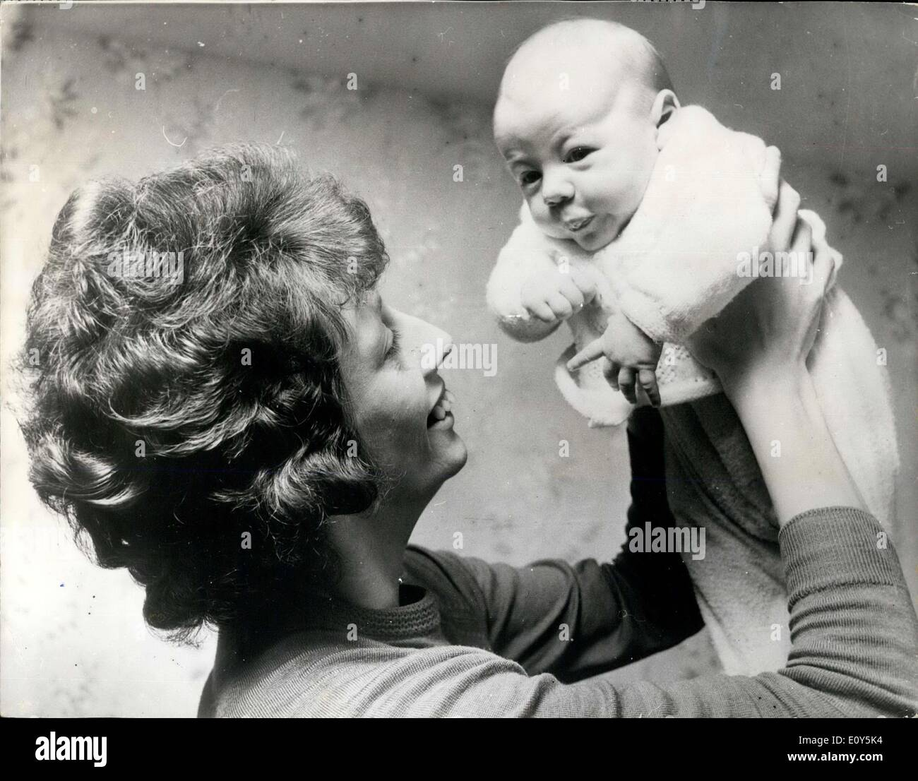 Feb. 25, 1969 - She Gambled With Her Life For A Baby: Two - months old Steven Sheard is the prise of lifetime for this mother, 28-year old Mrs. Evelyn Sheard. for when Mrs. Sheard decided to have a baby she was gambling with her own life. Three years ago Mrs. Sheard, of workington (Cumberland) had the artic valve in her heart replaced in a serious operation at the Hammer smith Hospital in London. ''After the operation surgeons pointed out the grave risk I would be talking i I had any children, partly because of the drugs I have to take said Mrs. Sheard - Stock Image