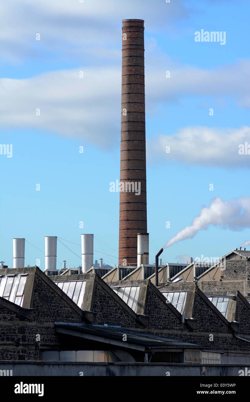 Chimney at the Michelin factory, Clermont-Ferrand, France - Stock Image