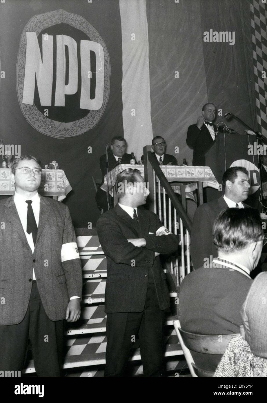 Nov. 22, 1968 - NPD - Huge rally in Munich. Around 800 people took part in a huge rally organized by the National Democratic Party of Germany(NPD) on the evening of Novelber 21; however, it eventually led to rioting. The speaker of the evening was Dr. Pohlmann, parliamentary party leader of the Bavarian NPD - state faction. The rally was organized under the motto: Two Years Work of the NPD in Bavaria. The ushers, denoted by white armbands, quickly worked against the so-called ''disturbers.'' Several people were taken to the hospital - Stock Image