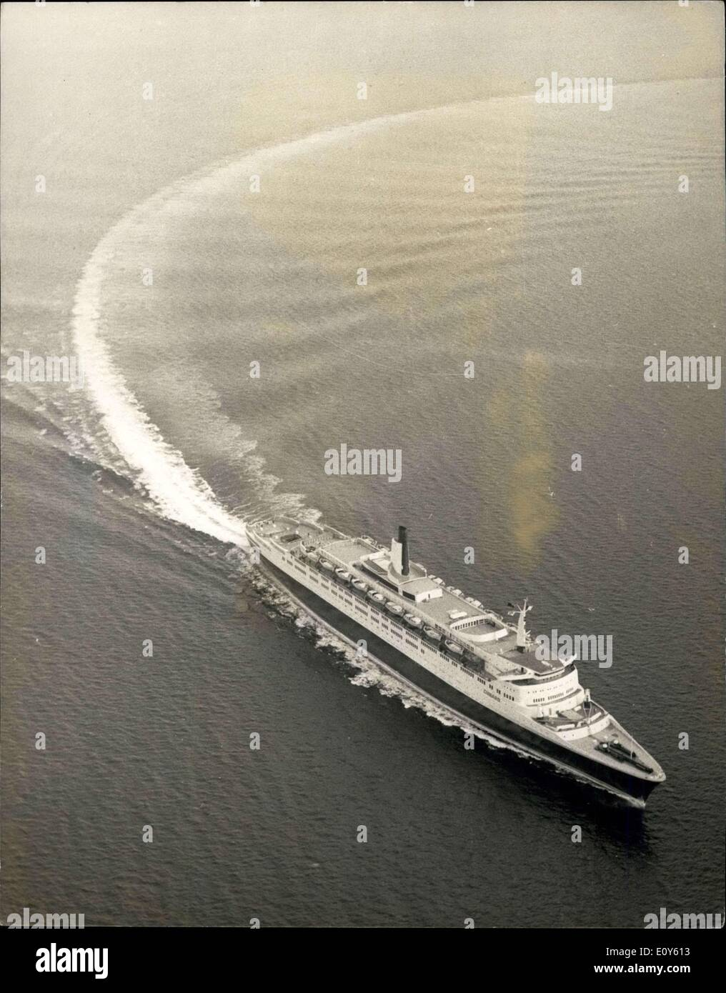Nov. 30, 1968 - Oil Leak Cuts Short QE2 Sea Trials - The Traials of the Cunardor Queen Elizabeth 2,65,000 tons, were interrupted yesterday because-oil had sceped into the water system in the boiler room. The ship returned from trials in the Firth of Clyde to her anchorage at Tail-of the-Bank and will re-enter the dry dook at Greenock Division of apper Clyde Shipbuilders, who is aboard the shipobservring the trails, said that the ship had undergone ''Satisfaction trails'' in perfect condions, she had carried cut fast working-up speeds but had not gone Full Ahead'' Over a Moasured Mile - Stock Image