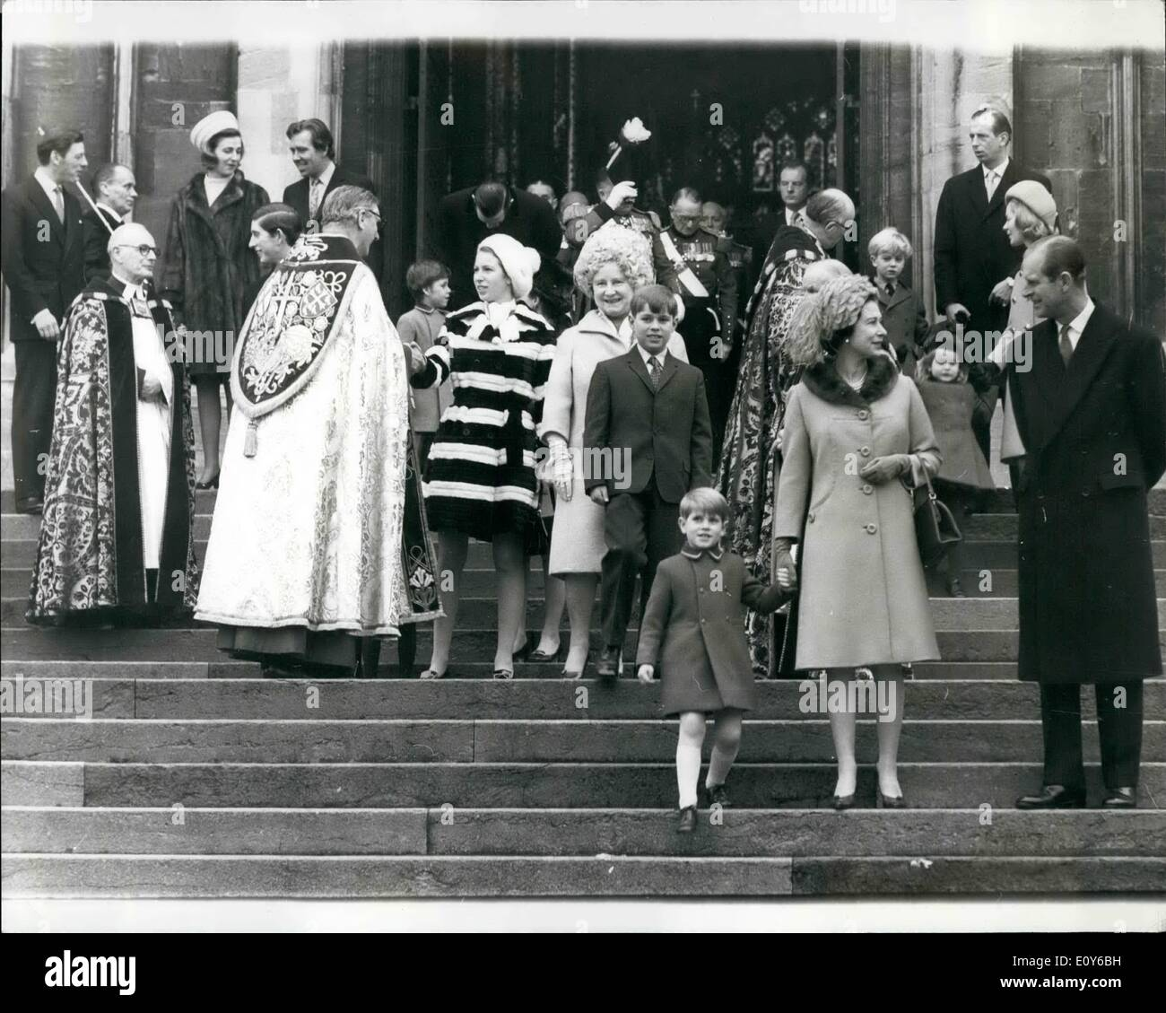 Dec. 12, 1968 - Royal family at Christmas service. members of the Royal Family leave St. George chapel Winsor on Christmas morning, after attending Christmas service there. In foreground Queen Elizabeth II hold the hand of her youngest son Price Edward, as she talks to her Husband Prince Phillip. Behind Prince Edward is Prince Andrew with his grandmother. Queen Elizabeth the Queen mother, while his sister Princess Anne shakes hands with Unidentified prelate. At top far left Angus Orgildy with his wife Princess Alexandra of Kent who is talking to Lord Snowdon - Stock Image