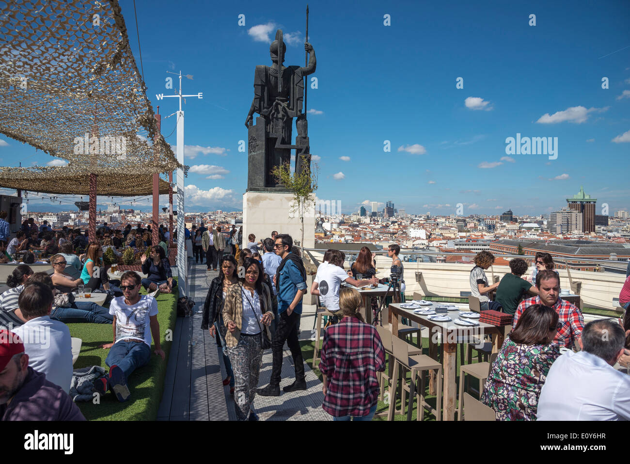 The rooftop cafe bar of the Circulo de Bellas Artes, with its statue of Minerva, Central Madrid, Spain - Stock Image
