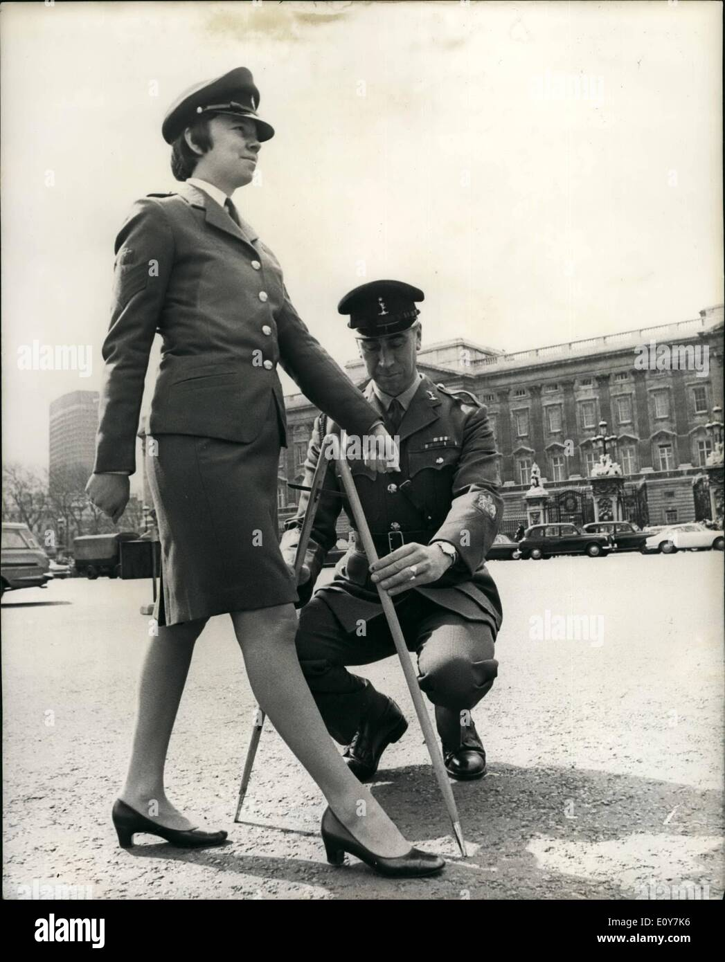 Apr. 04, 1969 - Pacing the Route; Pacing the route took place this morning of the first ever parade through London of the new ''territorials which will take place next Sunday (April 20). These pace makers who measured the route with pacing sticks formed up at the bottom of Constitution Hill. Opposite Buckingham Palace, from where 1,000 men and woman and 150 vehicles taking up the parade will start on April 20. They then paced the route in time honored manner. Past Buckingham Palace, into Bird cage walk as the guards at Parade - Stock Image