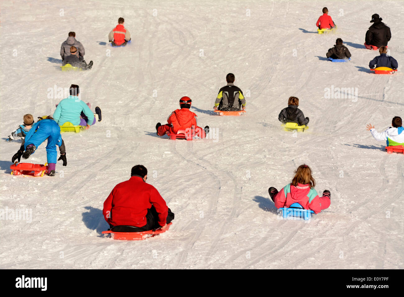 People sledging - Stock Image