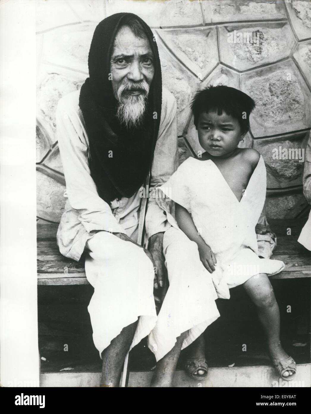 Feb. 02, 1969 - Hoping for the best in Vietnam-The very old and the very young : An elderly Vietnamese man sits patiently with his ailing grandchile for treatment at the outpatients clinic of the new Hoa Khan Children's Hospital near Da Hang. The new medical facility opened in January in one of the biggest U.S. Civic posts in South Vietnem. It will provide medical treatment for children in the fast browing refugee areas. - Stock Image