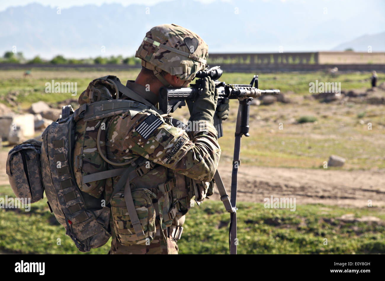 A US Army Airborne soldier keeps watch during a humanitarian Stock