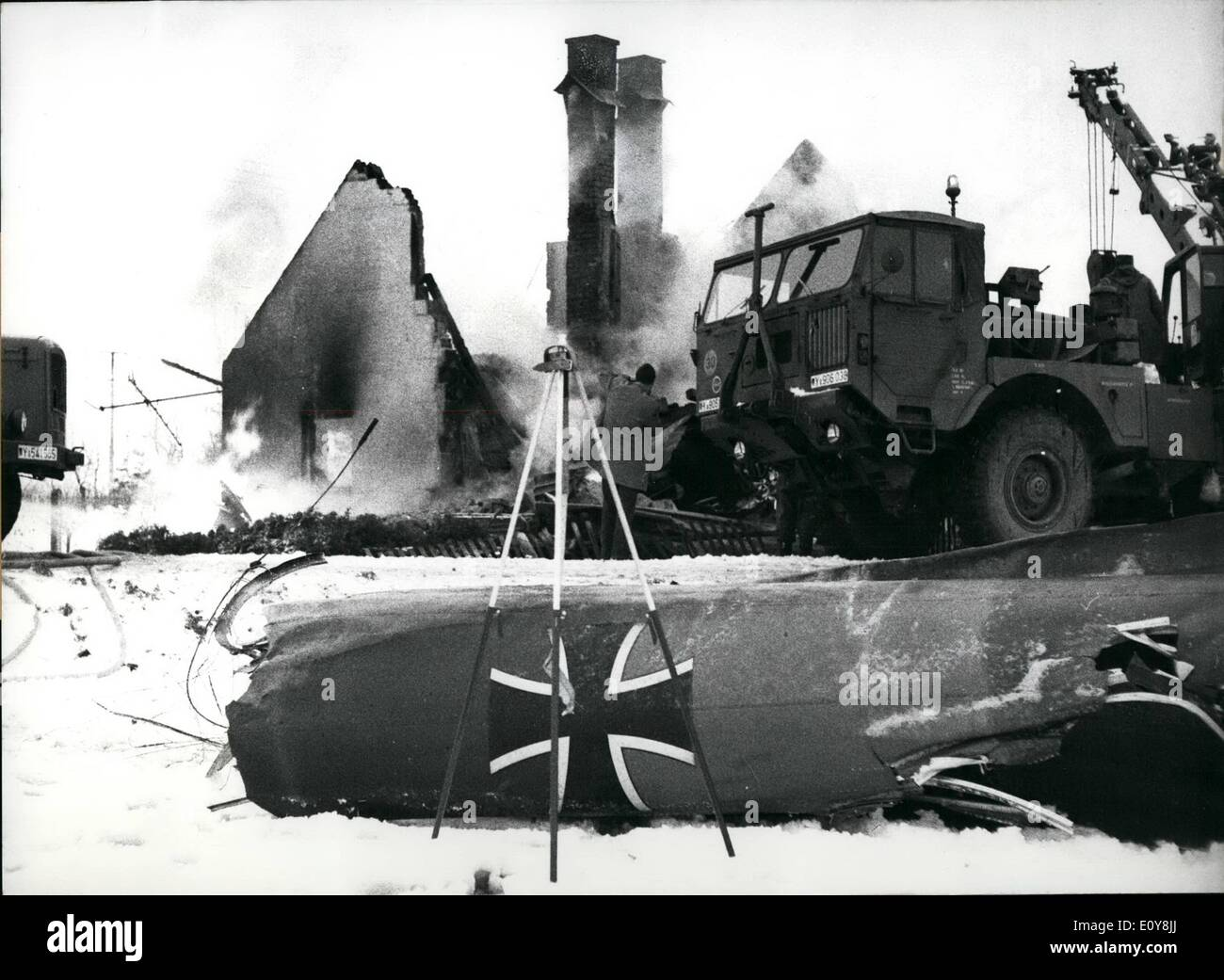 Feb. 02, 1969 - Airplane Crashed on house: A Nor-Atlas tranporting machine of the German Federal Army crashed in the district of Erding near Munich on 12 February,1969. The Airplane had 13 passangers on bord, nine were killed, four severely injured. A two-year-old child in the house on which the plane crashed, was killed too. Photo shows The demolished house and in the front the plane-ruins with the Bundeswehr-sign. - Stock Image