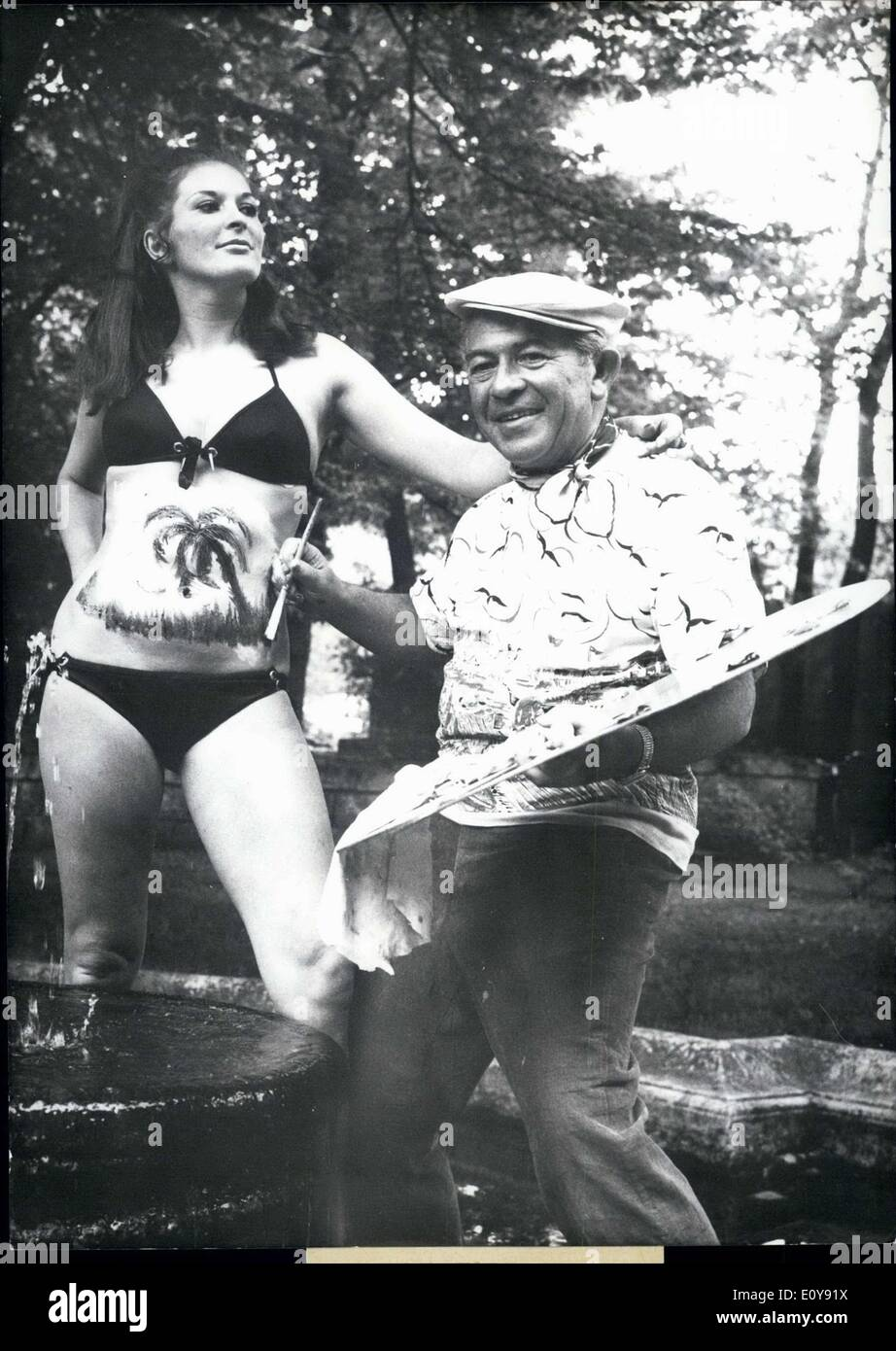 May 27, 1969 - American artist Edmund Adler is painting a ''vacation spot''  on the vacation-hungry model Renate Leeb.