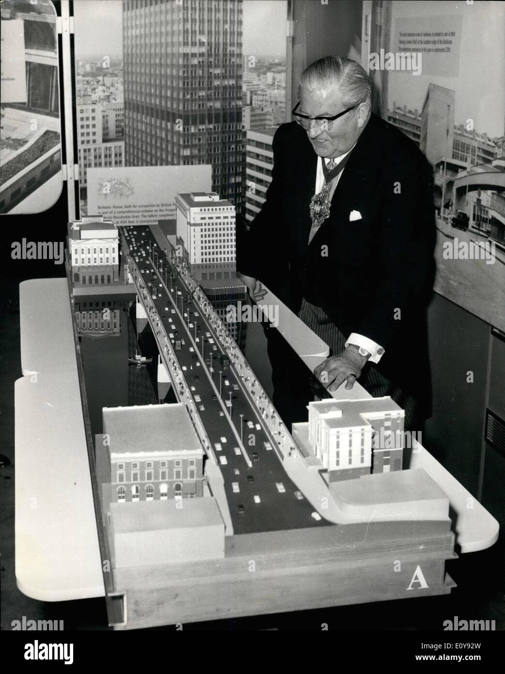 May 05, 1969 - Lord Mayor opens new City Exhibition: The Lord Mayor of London, Sir Charles Trinder, today officially opened a new Exhibition Hall which contains a display on the Modern City showing redevelopment in the Square Mile from Wren to the present day, a new Underground car park and new premises for the Guildhall Justice Room, all part of the Corporation of London's Reconstruction Scheme for Guildhall Precincts. Photo Shows The Lord Mayor of London, seen after the opening, examining a model of the new London Bridge. - Stock Image