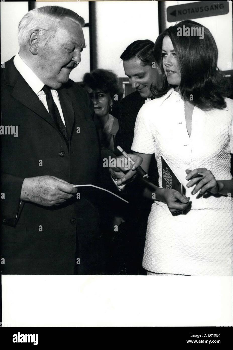 Sep. 01, 1969 - Among the cigar smokers is Germany's most prominent smoker, former Chancellor Dr. Ludwig Erhard. The old chancellor opened the K?ln tobacco products show ''TAFA 69.'' During his roundabouts at the show the ex-chancellor is seen here speaking with theater-actress Rosemarie Decker about their common interests. - Stock Image