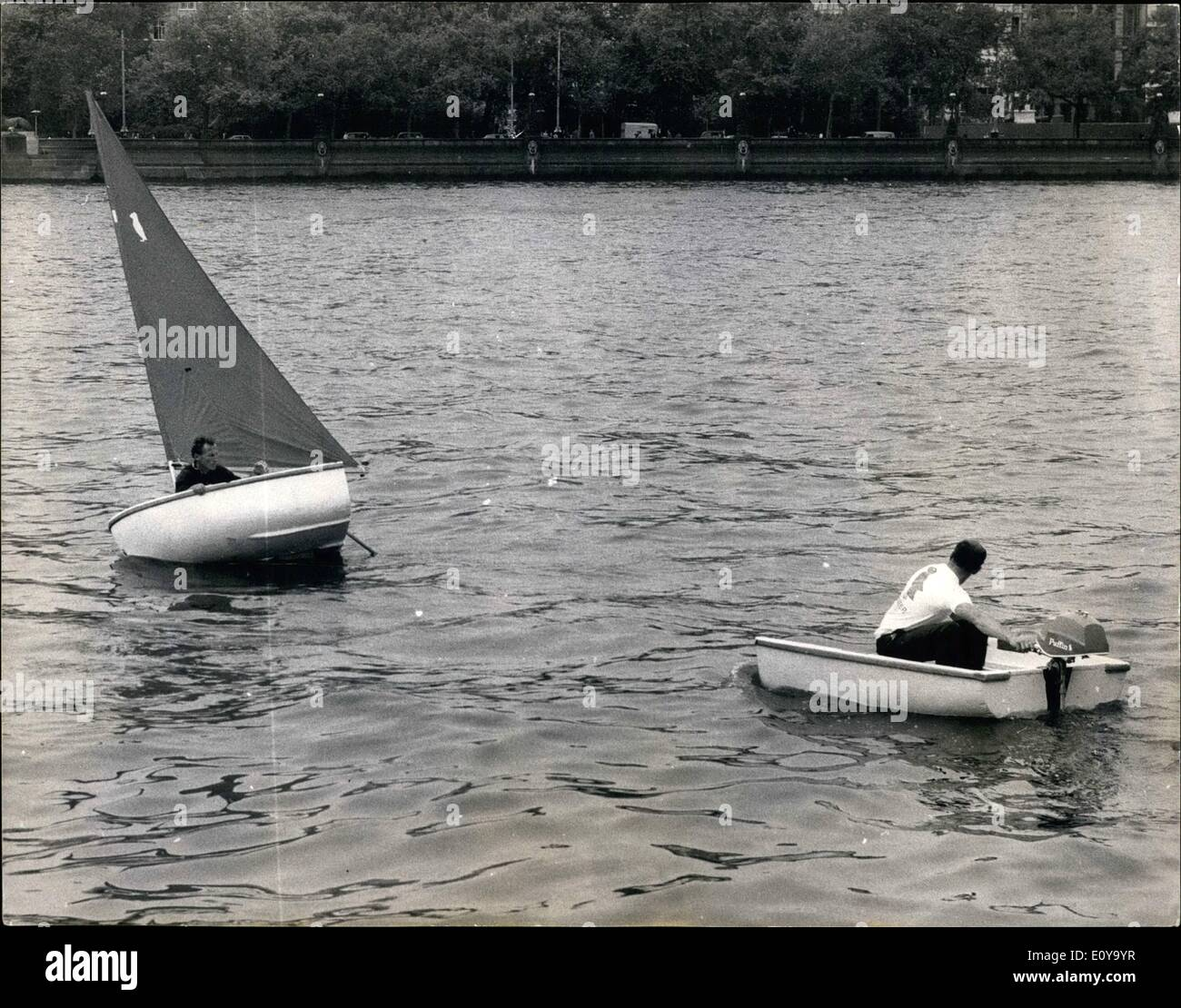 Jun. 06, 1969 - The new lightweight 'Pioneer' Dinghy in Polystyrene is demonstrated on the Thames: The ''Pioneer'', a revolutionary 9ft. 6 in. dinghy a product of the unique combination of the expertise of the famous yacht designer, Roland Prout and a team of chemists from the Polycell Laboratories, was demonstrate on the Thames today. Because it is moulded in high density Polystyrene and is made by mass production methods, it is new possible to market the beat,complete with sails, mast and all gear for only £59 - Stock Image