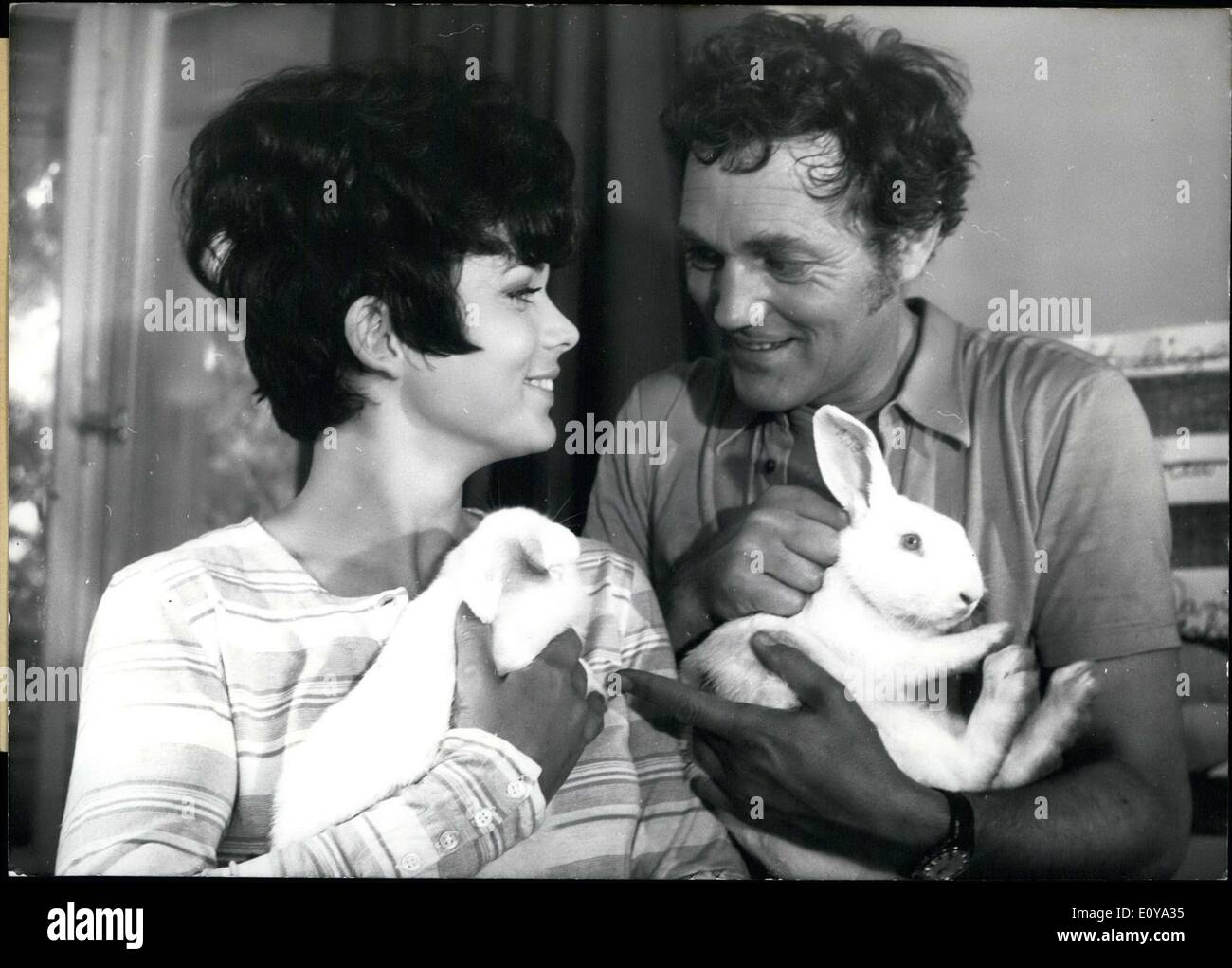 Jun. 25, 1969 - Harald Leipnitz and Uschi Glas are pictured here holding bunny rabbits. Leipnitz is starring along with Glas in - Stock Image