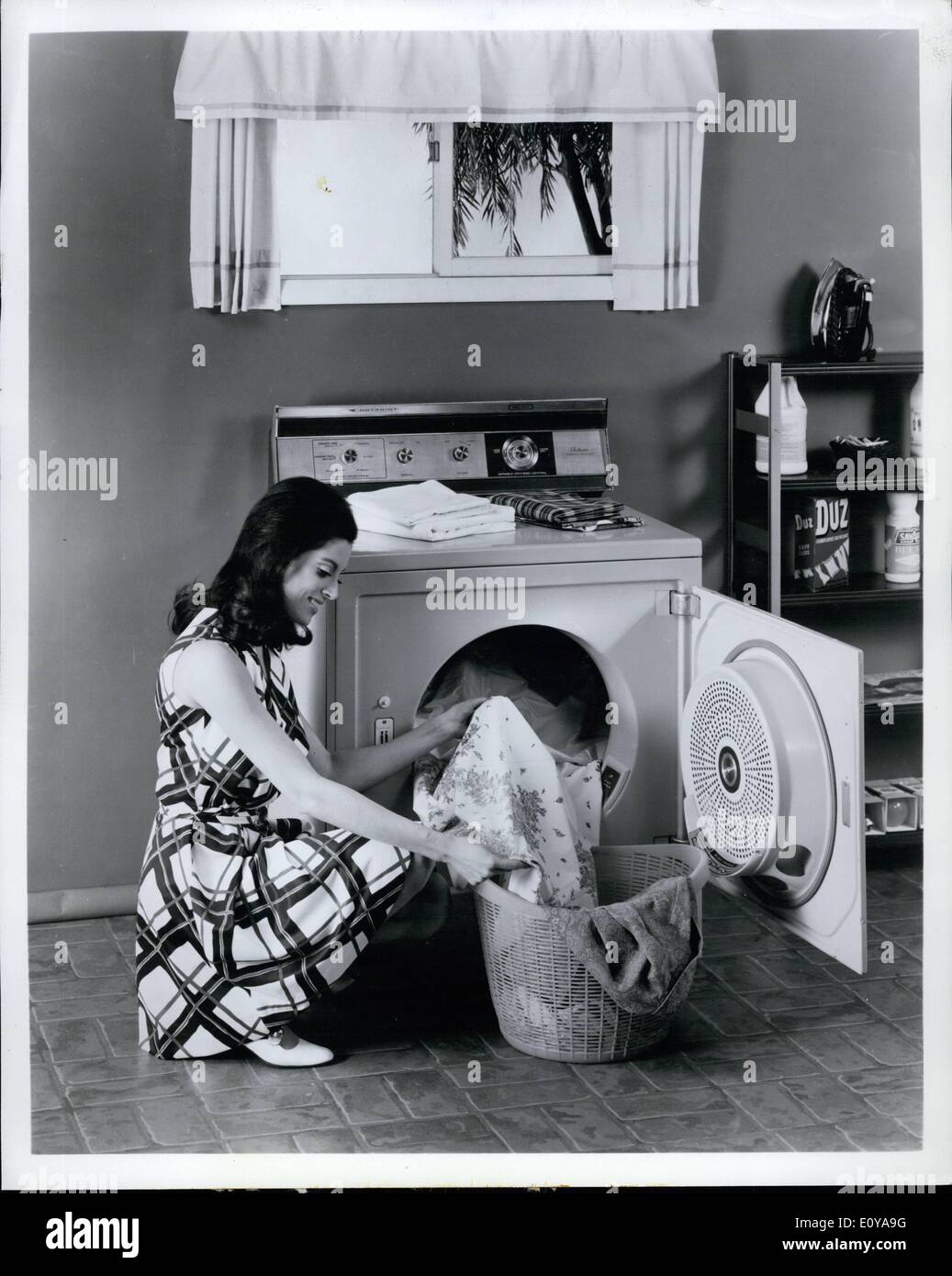 Sep. 09, 1969 - For Immediate Release: Automatic dryers with big-capacity drums to handle permanent press clothing and household lines properly are new from Hotpoint. This 7.5-cubic-foot-capacity dryer features an electronic moisture sensor which gauges the correct degree of dryness in each load and shuts the dryer off automatically - Stock Image