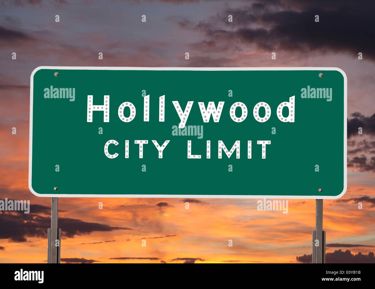 Hollywood city limits sign with sunset sky. - Stock Image
