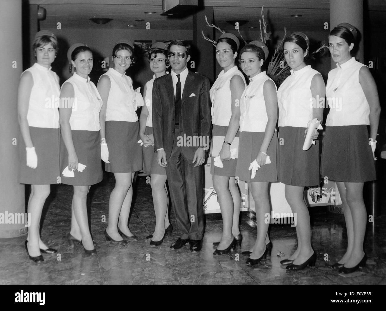Alexander Onassis with Olympic Airways flight attendants - Stock Image