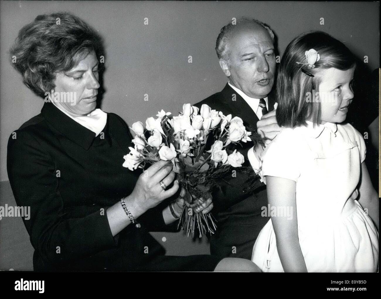 Jul. 18, 1969 - Walter Scheel marries in Munich. The FDP chairman Walter Scheel married doctor Mildred Wirtz (37). Mildred Wirtz has a six year old daughter. It is the politician's second marriage. He brings a 24 year old son to this marriage. Pictured: The last arrangements before the marriage ceremony: Dr. Wirtz arranges her bridal bouquet and Scheel checks the fit of the dress of future step daughter Cornelia. - Stock Image