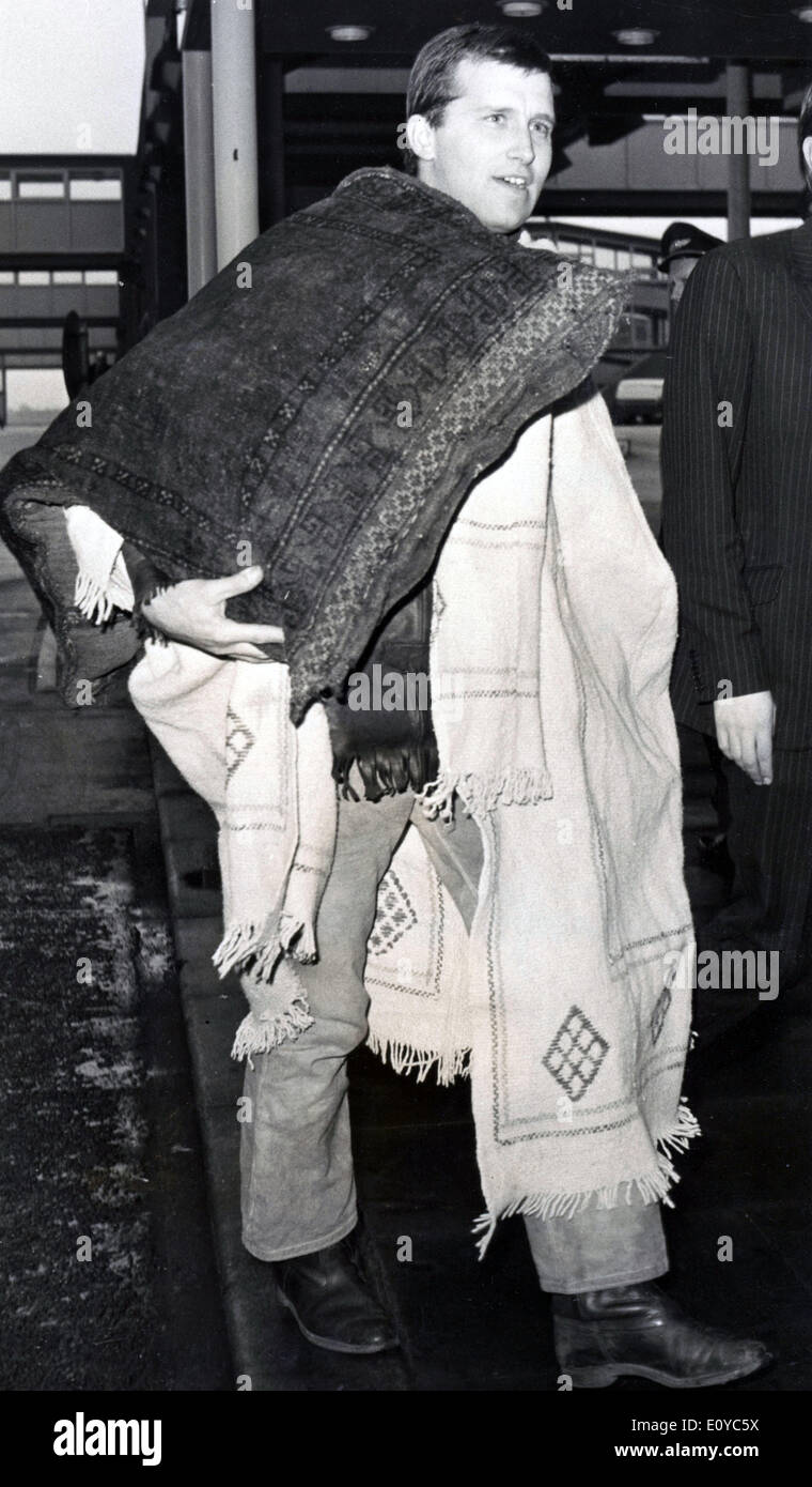 Oct. 25, 1969 - London, England, U.K. - ANTHONY LORRAINE loaded with his possessions arrives at Heathrow Airport from Moscow after being jailed their for alleged drug offenses. - Stock Image