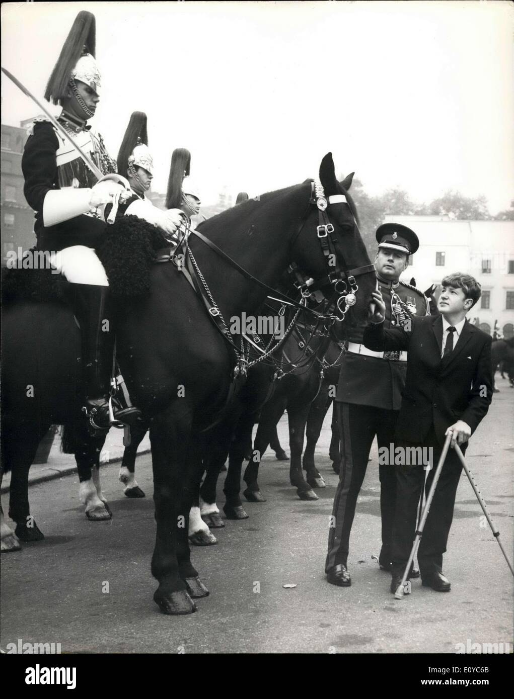 Oct. 28, 1969 - A different kind of Escort for the Household Cavalry: Ian Brown, a 14-year-old pupil at the Woodlands School for physically Handicapped children in Plymouth, sent an old picture postcard of Horse Guards to the Household Cavalry decided, rather that try to personalise the building in a letter, that it would be much better if Ian, together with his mother, could be brought up to Lonodn to see it for himself - Stock Image
