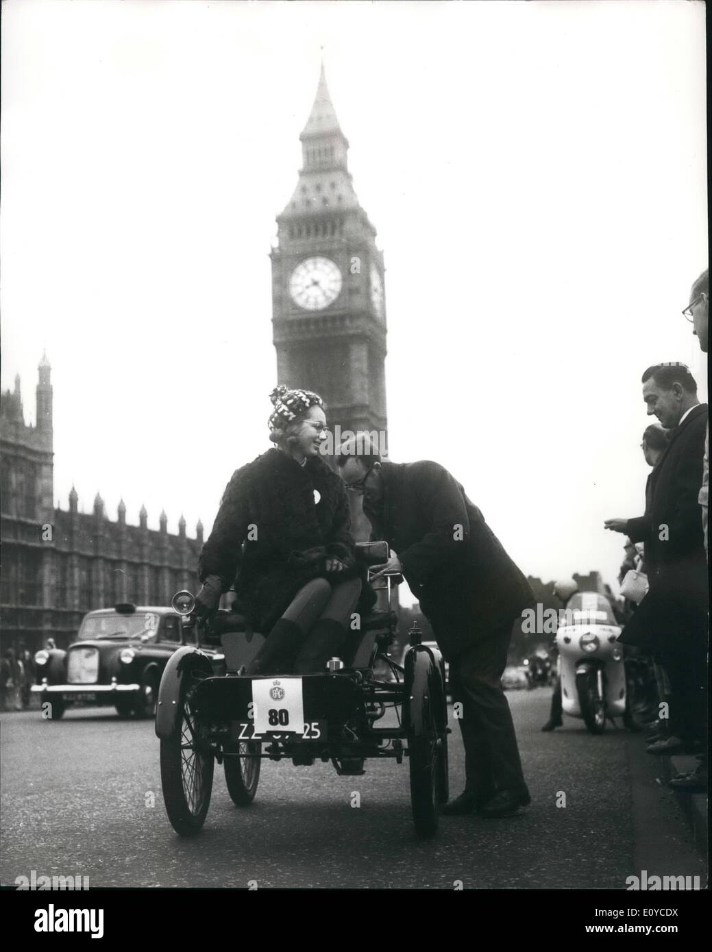 Nov. 11, 1969 - The Veteran Car Club's London To Brighton Run: The annual R.A.C.'s Veteran Car Run to Brighton took place today. The competitors moved off from Hyde Park for the 50 mile Journey to Brighton. Photo Shows A breakdown in the shadow of Big. Ben. Mr.C.T. Steffelaur gets to work on his 1901 De Dion Bouton after it ran in to a spot of trouble on Westminster Bridge this morning. - Stock Image