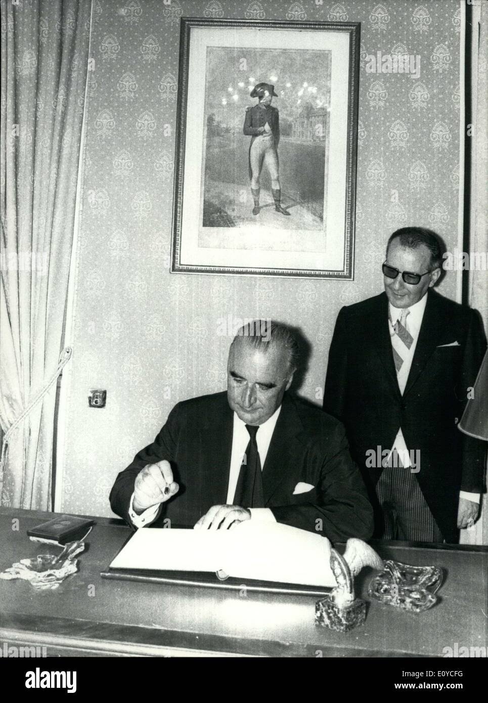 Aug. 16, 1969 - President Pompidou attended ceremonies marking the bicentennial of Napoleon I's birth. Georges Pompidou signs the ''Golden Book'' in the city hall of Ajaccio. The Mayor, Pascal Rossini is behind him. - Stock Image