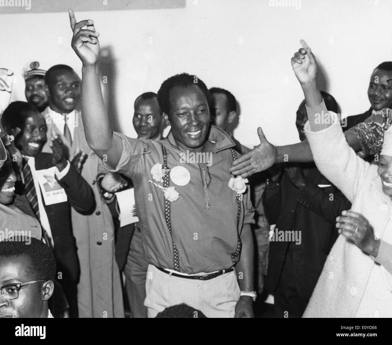 Dec. 4, 1969 - Nairobi, Kenya - Dr. NJOROBE MUNGAI celebrates, by waving his hands showing the 'Kanu' symbol after he retained his seat of the Dagorreti. - Stock Image