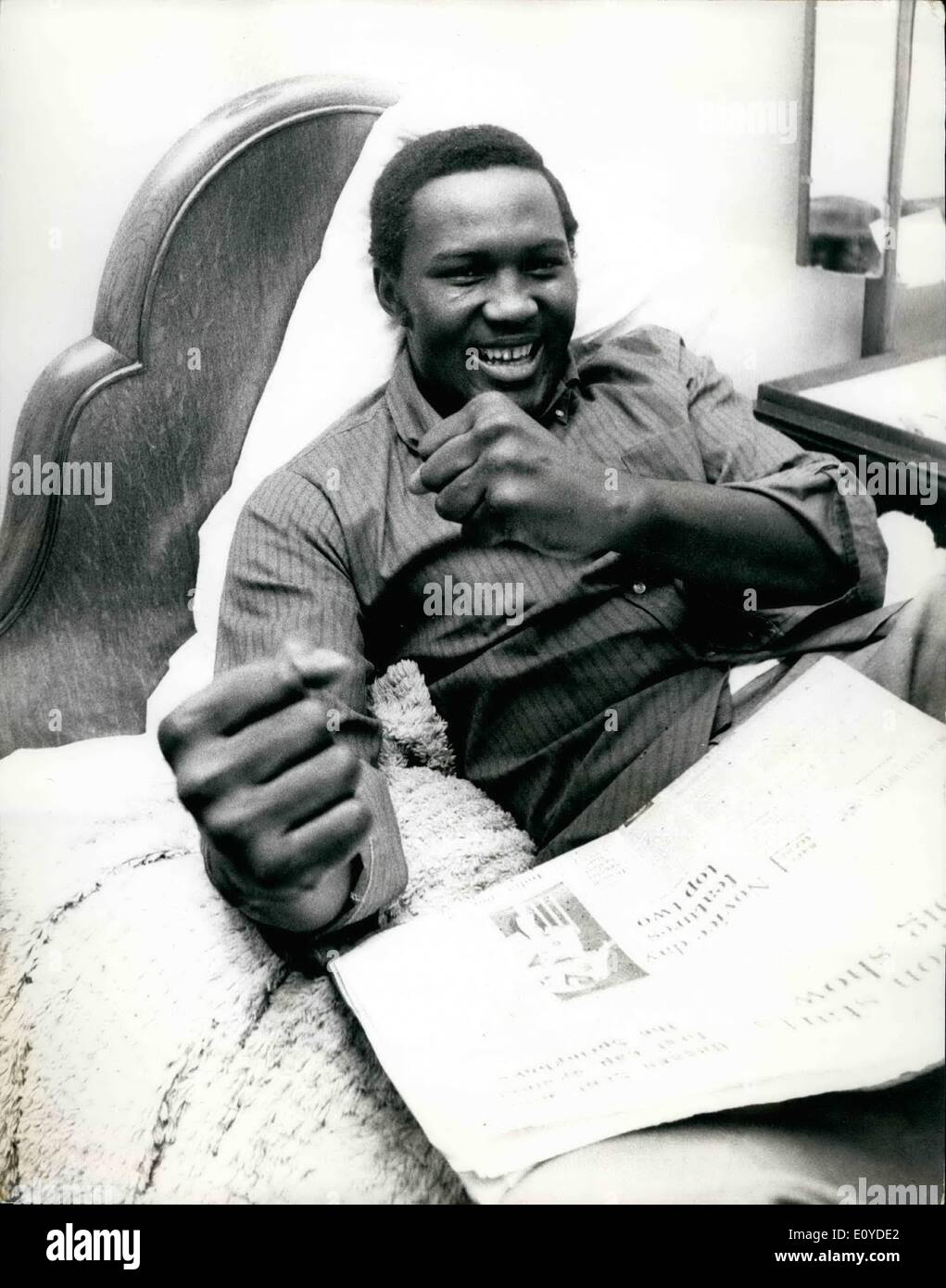 Dec. 12, 1969 - Charles Polite The American Heavyweight Arrives For His Fight With Joe Bugner: Charlie Polite, the American Negro heavyweight, from Springfield, Mass, who had the privilege of facing world champions, Joe Frazier, and Bob Foster and outside Buster Mathis, has arrived here in preparation for his contest against Britain's 19-year-old heavyweight, Joe Bugner, at the Albert Hall on December 9th. Photo Shows Charlie Polite is pictured relaxing on his bed at the Regent Palace Hotel Piccadilly today. - Stock Image