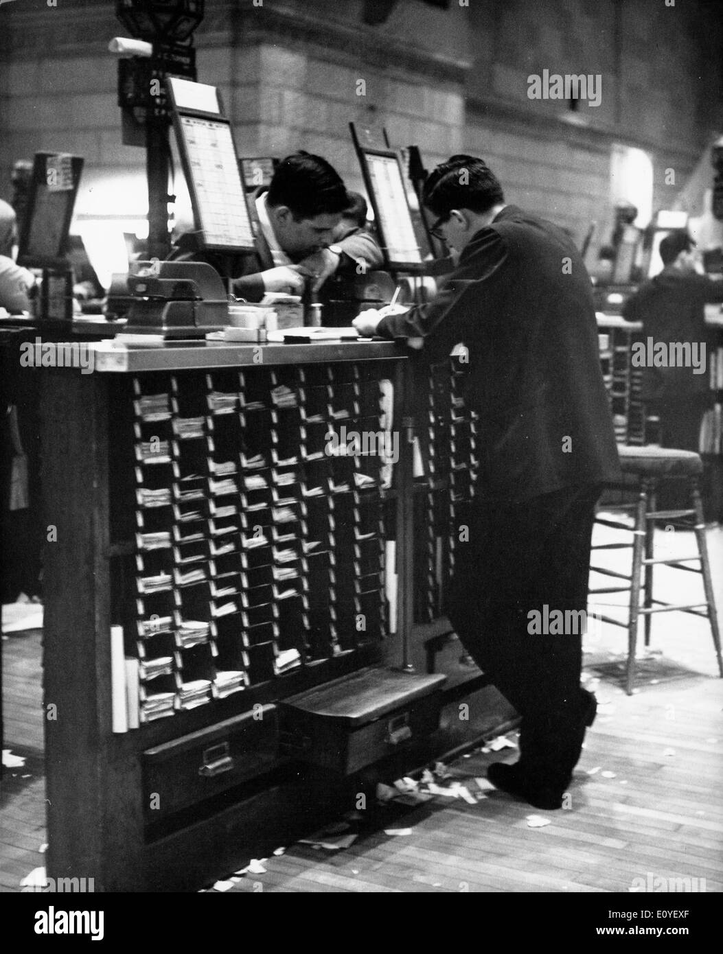 Jan. 01, 1970 - New York, New York, U.S. - File Photo: circa 1970s. Trading post in the Stock Exchange as business wanes and the floor's covering of slips grows. - Stock Image