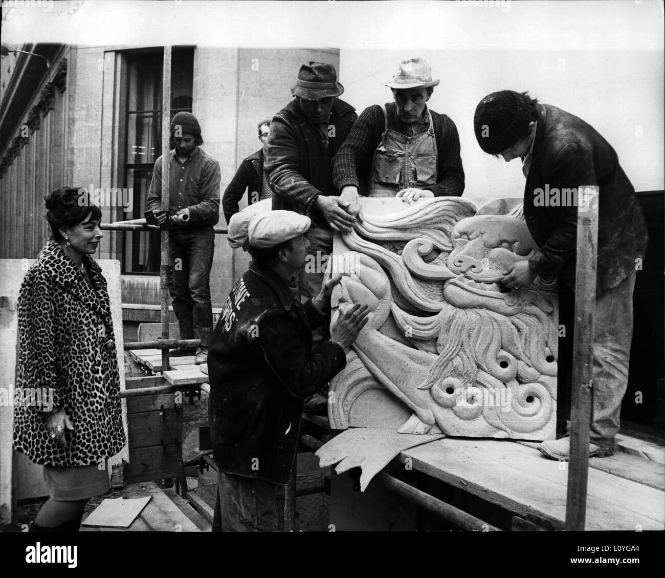 Apr. 04, 1970 - Sculptress Watchers Motifs Placed In Position: Sculptress Mitzi Cunliffe came from Brighton to watch her 6ft. square Scottish motifs being placed in position on the facade of the Scottish Life Assurance Company's new building in the City. Photo shows. Mitzi Cunliffe supervising the placing of the stone blocks today, on the faccade of the Scottish Life Assurance Company's building in the City, today. - Stock Image