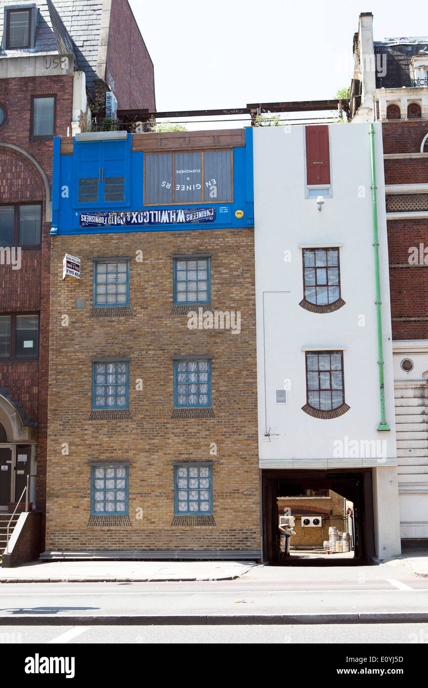'Under the weather but over the moon' by artist Alex Chinneck a Topsy turvy upside-down house on Blackfriars Road, London, UK - Stock Image