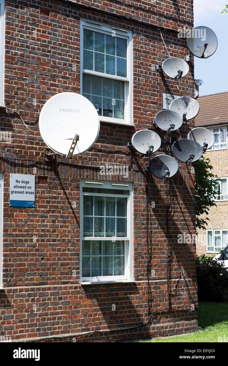 Satellite dishes on the outside of Lant House, Toulmin Street, London, England, UK. Stock Photo