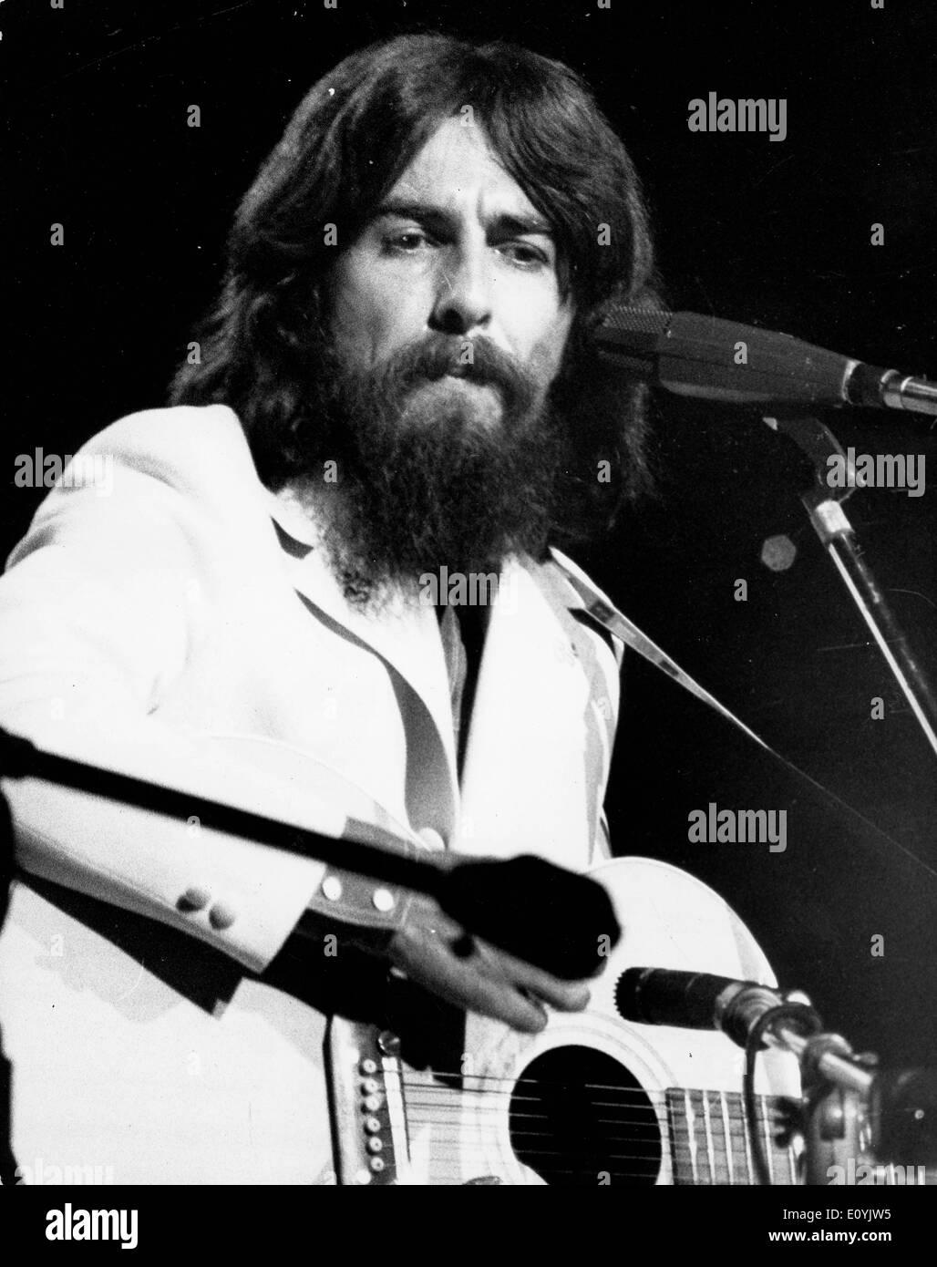 Beatles Guitarist George Harrison performs in concert - Stock Image