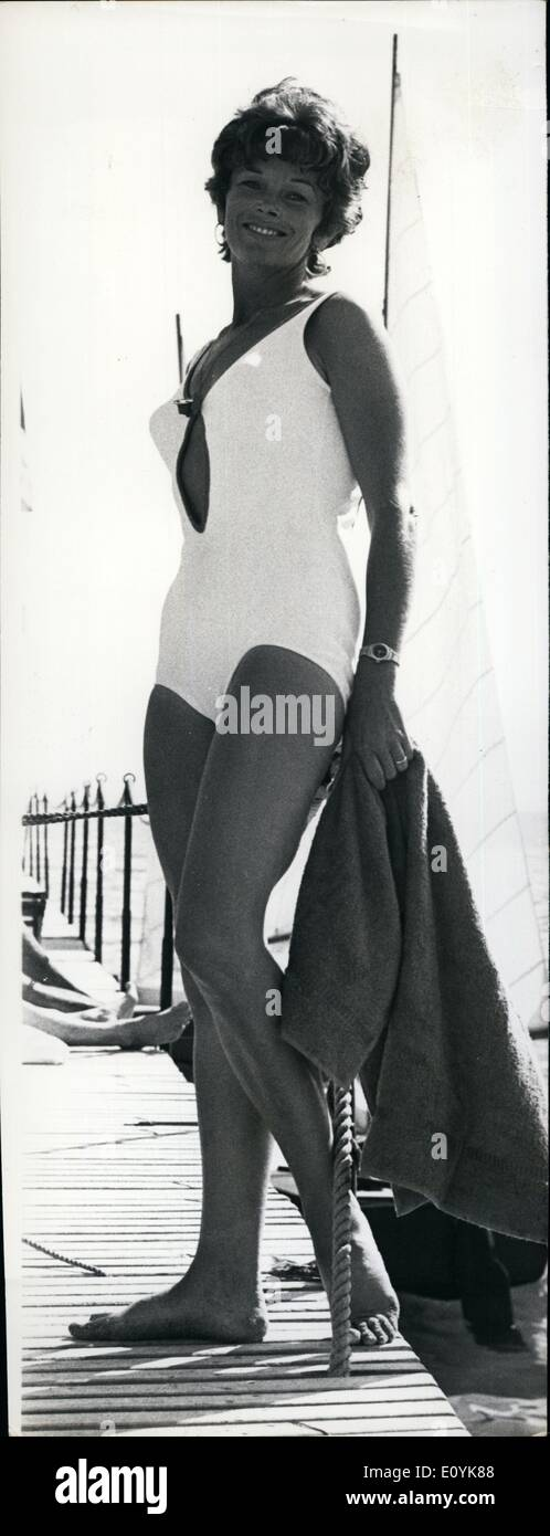 Aug. 08, 1970 - Adams is currently filming the movie ''Sapho'' in Cannes. She is pictured here taking a break from Stock Photo