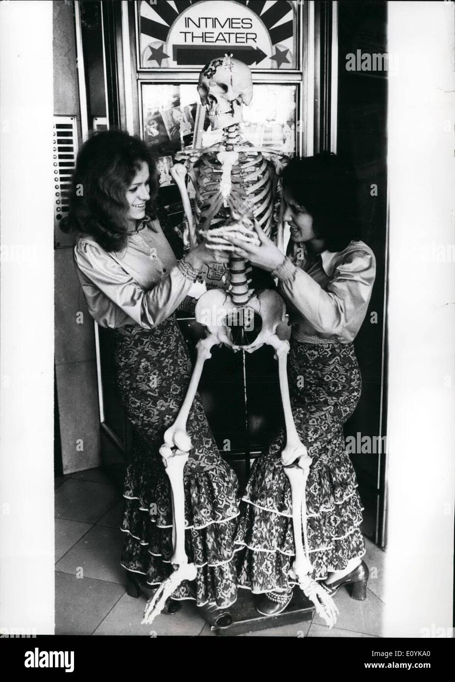 Aug. 08, 1970 - A new gag: is having the ''Intimes Theater'' in Duesseldorf, W. Germany, not in its programme, though, but after the show. As a souvenir the visitors can have a rather extravagant photo made of themselves - together with a plastic skeleton, with which our two ''maxi-girls'' are posing here (photo) - Stock Image
