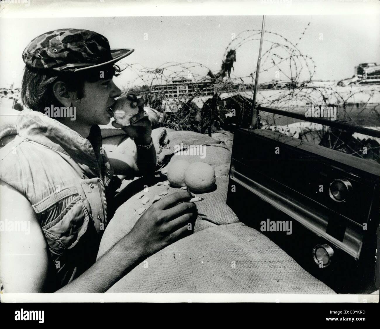 Sep. 09, 1970 - Enjoying the Ceasefire along the Suez Canal: With the Ceasefire being fairly well adhered to along the Suez Canal itself -Israeli soldiers are relaxing at the BarLev Line facing the canal, constant action and life practically underground in the bunkers. At the same time they are ever at the ready,prepared for any eventuality. A month age if someone had seen a Soldier with out his helmet standing outside in the sun. gazing sears the canal through his binoculars, he would have thought he was dreaming. now this is part of the way of life - Stock Image
