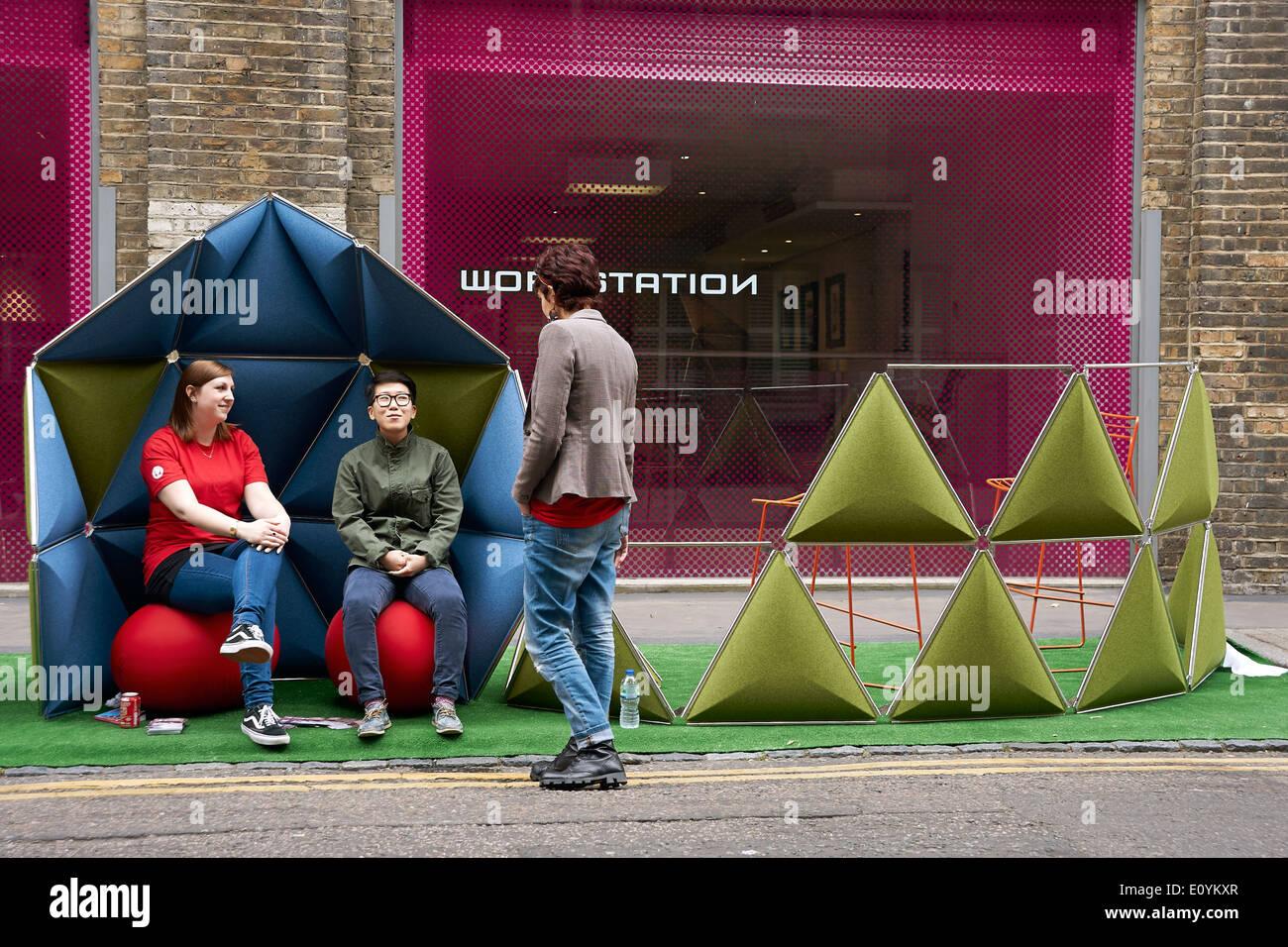 people enjoying Street Design furniture at Clerkenwell Design Week 2014, London Stock Photo